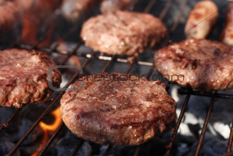 food meat - burgers on barbecue grill.