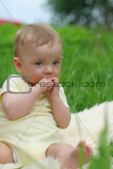 Small kid in grass