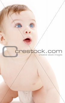portrait of crawling baby boy looking up #2