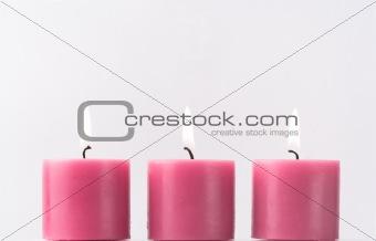 Three pink candles