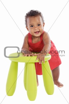Toddler playing with a chair
