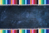 Chalkboard Texture Background with Rows of Colored Pencils