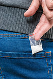 bag with the drug dose in a pocket close-up drug dealer