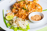 Traditional Thai dish noodles with seafood with beans on a plate
