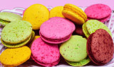 Multicolored macaroons in a plate,