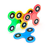 four fidget spinner in different colors