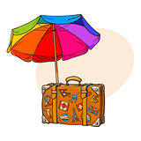 Rainbow colored, open beach umbrella and travel suitcase with luggage stickers