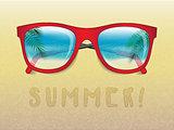 sunglasses reflecting tropical landscape