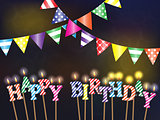 Greetings happy birthday with the lights and burning candles