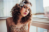 Fashion photo of beautiful girl wearing sparkling evening dress