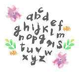 Hand drawn alphabet written with brush pen. Letters are decorated