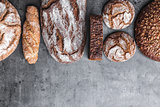 Delicious fresh brown bread on wooden background