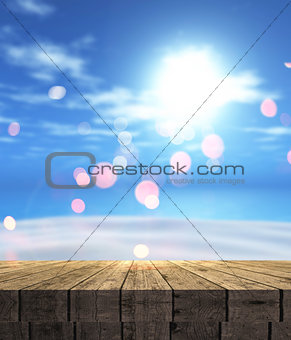 3D wooden table looking out to a summer landscape with sand, sea