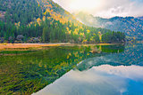 Autumn view of the lake with pure water at early morning time.