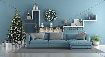 Blue modern living room with christmas tree