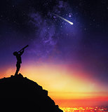 Child observes starry sky with a telescope