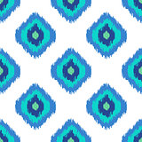 Ikat geometric seamless pattern. Turquoise blue collection.