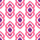 Ikat geometric seamless pattern. Pink and violet collection.