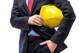 Yellow helmet in the hands of a businessman close-up
