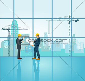 Architect and engineer plan on construction site