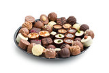 various chocolate pralines on plate