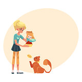 Teenage girl giving food to her fluffy red cat