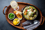 Seafood fish soup in clay bowls served with cold white wine. Top view, copy space