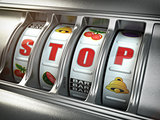 Stop gambling addiction concept. Slot machine with text stop.