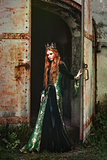 Woman in green medieval dress