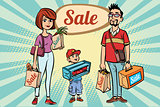 family dad mom and son with shopping on sale