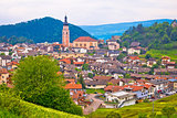 Idyllic Alpine town of Kastelruth on green hill view