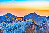 Sunrise above colorful peaks of Huangshan National park.