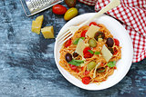 Spaghetti pasta with tomato sauce and olives