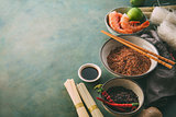 Different types of rice and dried asian noodles and spices.