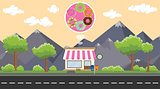 donuts store business on beside street with mountain view as background