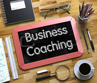 Business Coaching - Text on Small Chalkboard. 3D.