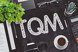 TQM Handwritten on Black Chalkboard. 3D Rendering.