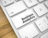 Business Analytics - Message on the White Keyboard Button. 3D.