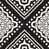Black and white tribal vector seamless pattern with doodle elements. Aztec abstract art print. Ethnic ornamental hand drawn backdrop.