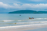 Wooden Thai boats in the pure Andaman Sea. Seascape