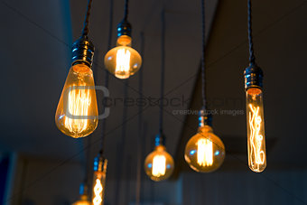 Old retro lamps hang from the ceiling