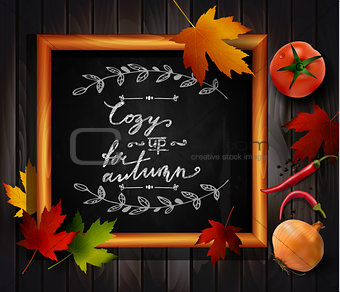 Chalkboard with autumn leaves