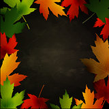 Frame of autumn leaves painted on black chalkboard