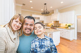 Happy Young Mixed Race Family Having Fun in Custom Kitchen.