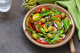 Mediterranean salad with olives, red onions and tomatoes