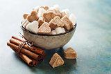 Brown cane sugar and a white sugar in a bowl