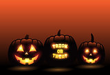 Vector carved pumpkins in front of orange gradient halloween background