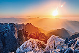 Sunrise above the mountain peaks of Huangshan National park.