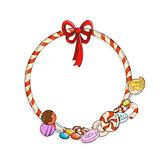 Frame of candy cane with candies and lollypops.