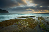 Moody day over Bilgola rockshelf Australia